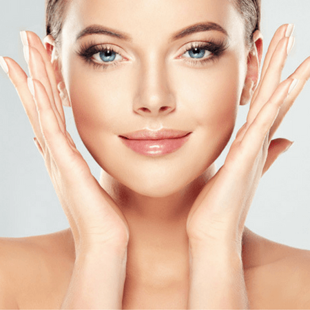 Model accenting her face with hands